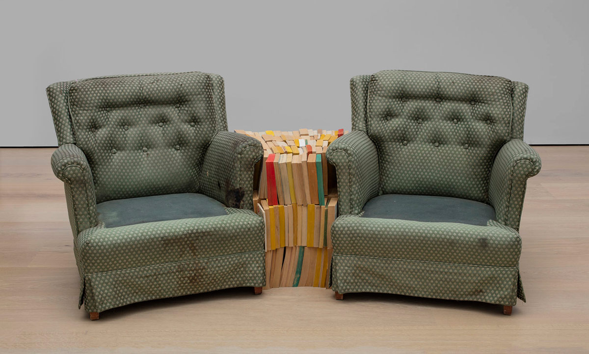 """Rodney McMillian, """"Chairs and Books,"""" 2004. Found armchair, found books. Dimensions variable. Hammer Museum, Los Angeles. Gift of Peter Norton. © 2004 Rodney McMillian. From the exhibition belonging. Hammer Museum, Los Angeles. 
