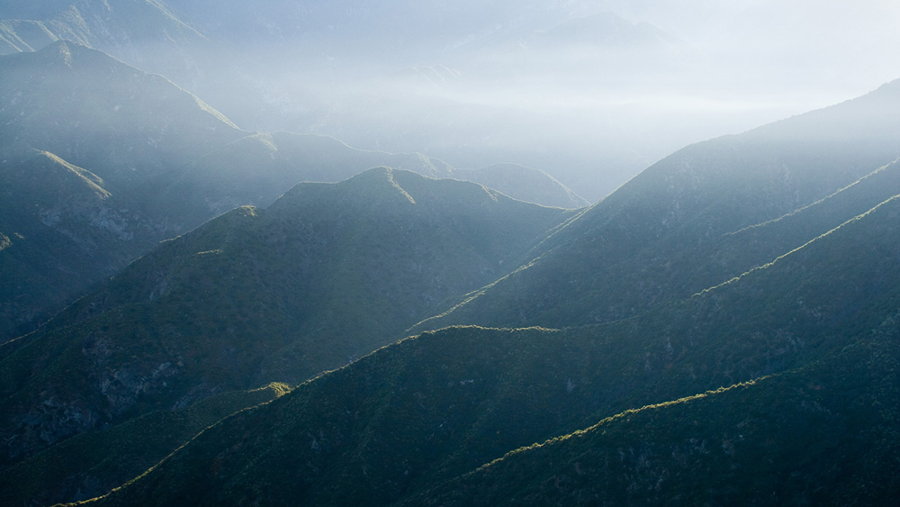 Morning light and atmospheric haze over the Sheep Mountain Wilderness | Photo: Michael E. Gordon
