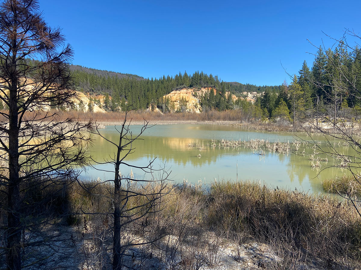 Water collecting at the bottom of the pit in Malakoff Diggins State Park. Every year, 100 grams of mercury flow from this pit into the watershed of the Yuba river.   Alexandria Herr