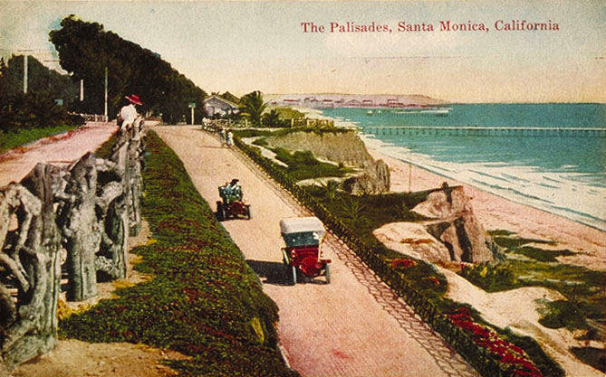 Early automobiles, including a Ford Model T, descend Santa Monica's California Incline in the early 20th century.