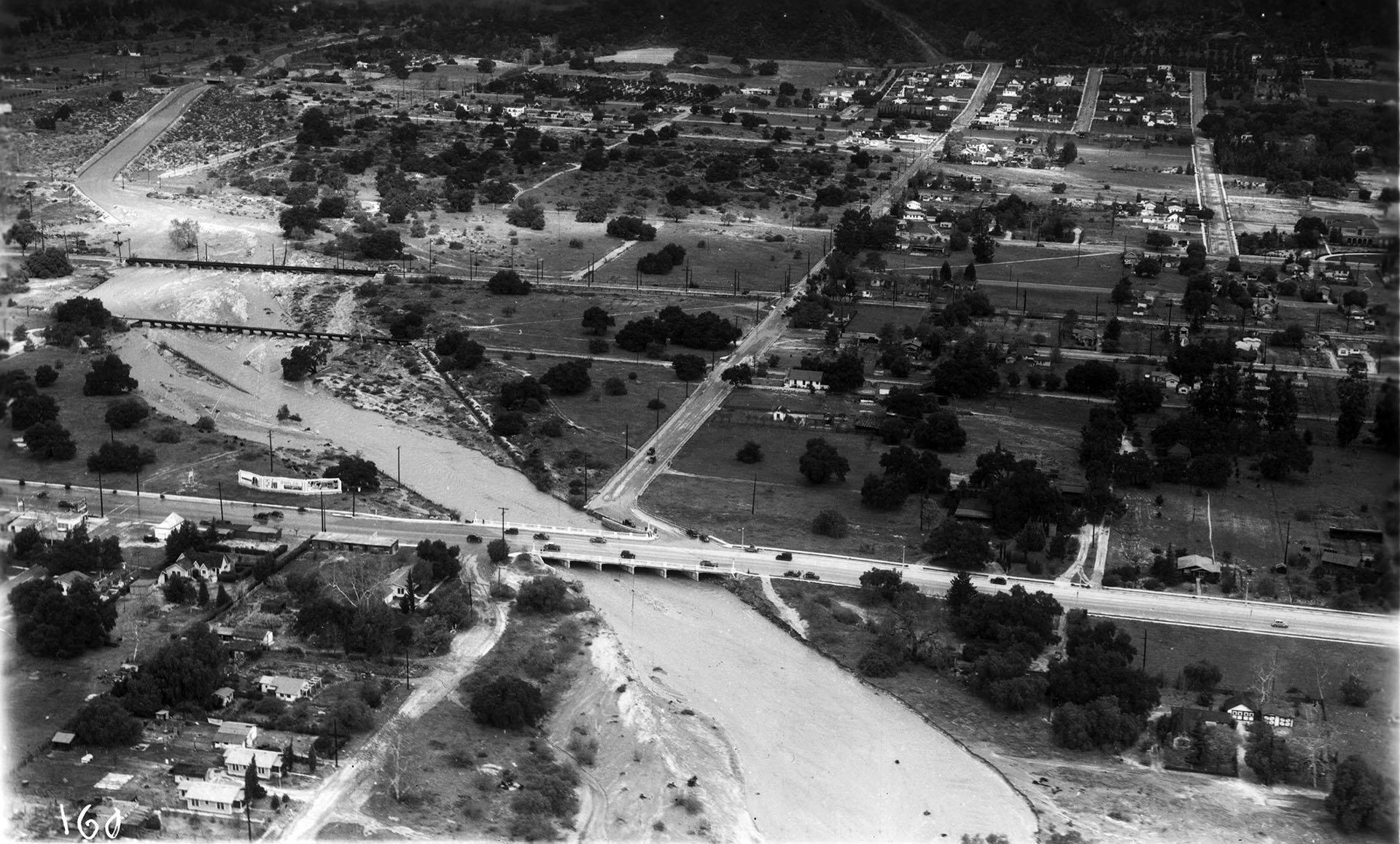 A swollen Big Santa Anita Creek in Monrovia, 1938