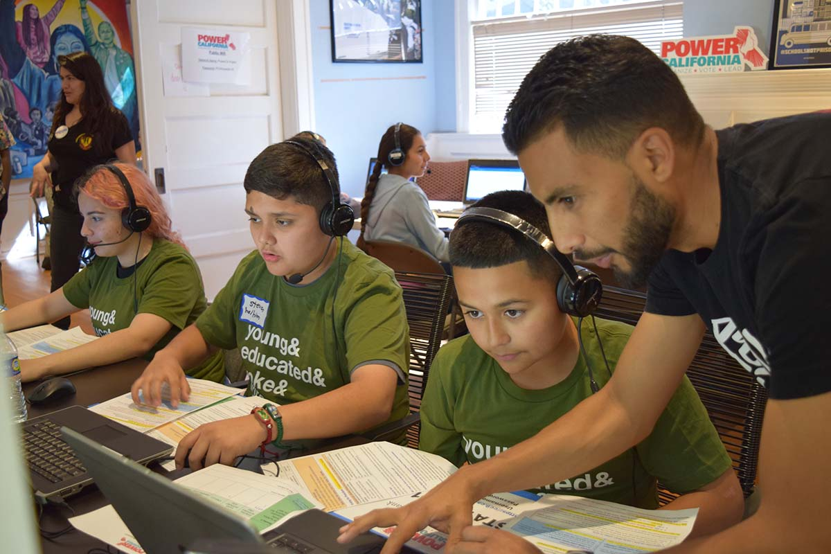 Power California Field Director Mynor Godoy assists volunteer phone bankers at a GOTV event in Los Angeles in February 2020 | Jay Banks