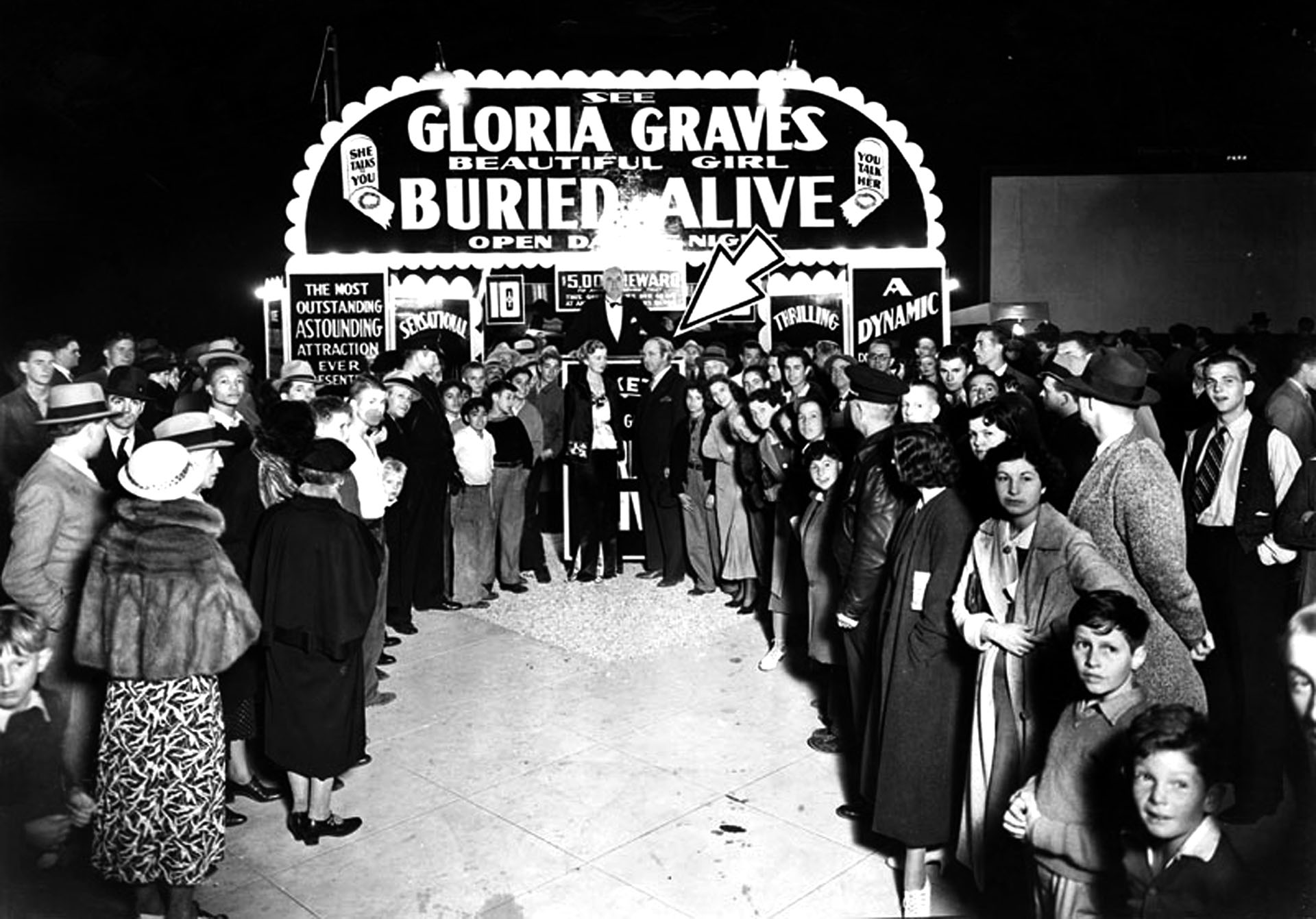Mysterious Mr. Q. The arrow points out Robert Godwin (also known was Mr. Q) standing beside Gloria Graves at her burial site. Photograph courtesy of Herald-Examiner Collection, Los Angeles Public Library