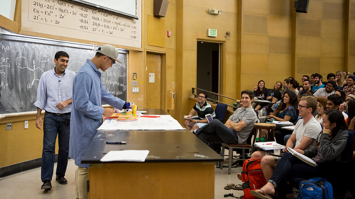 Neil Garg uses humor to create a fun and engaging learning environment. In this class, he compared the process of retrosynthesis to creating a sandwich, as a student volunteer assembled a sandwich. | Coral von Zumwalt, Courtesy of UCLA