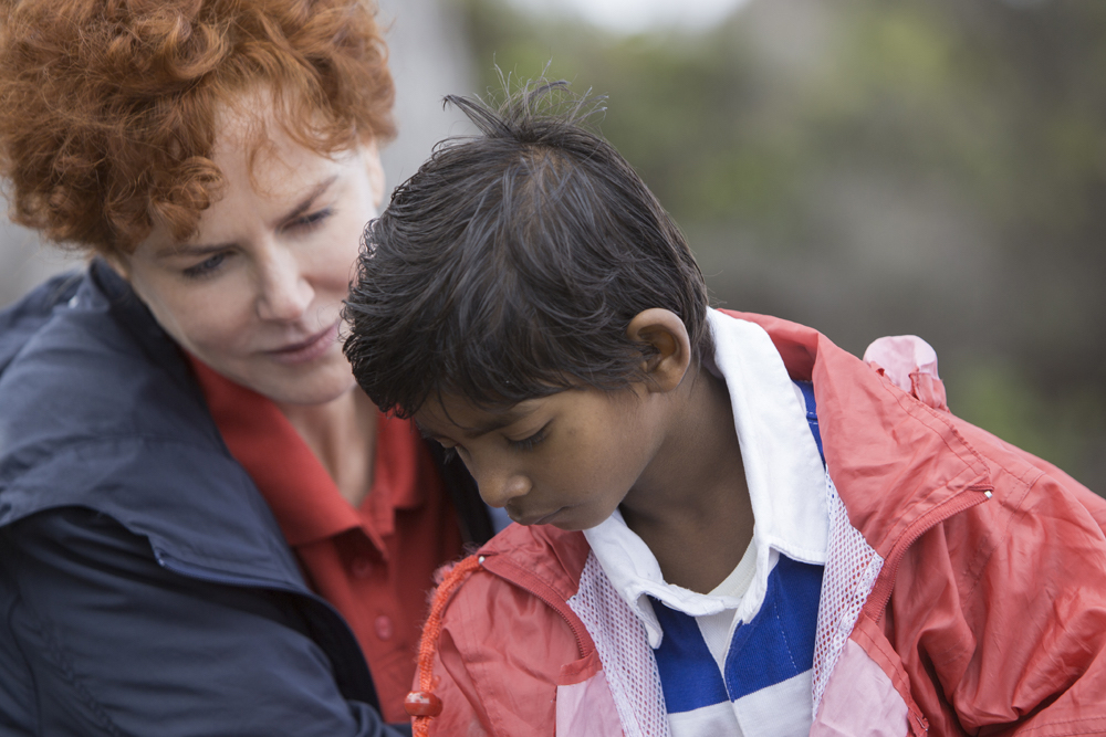"Nicole Kidman (as Sue Brierley) and Sunny Pawar (as a young Saroo Bierley) in the film ""Lion."""