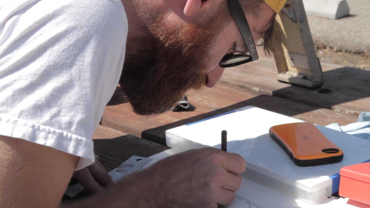 "Nikko Mueller drawing at San Clemente Border Station for ""Three Border Ecologies"" 