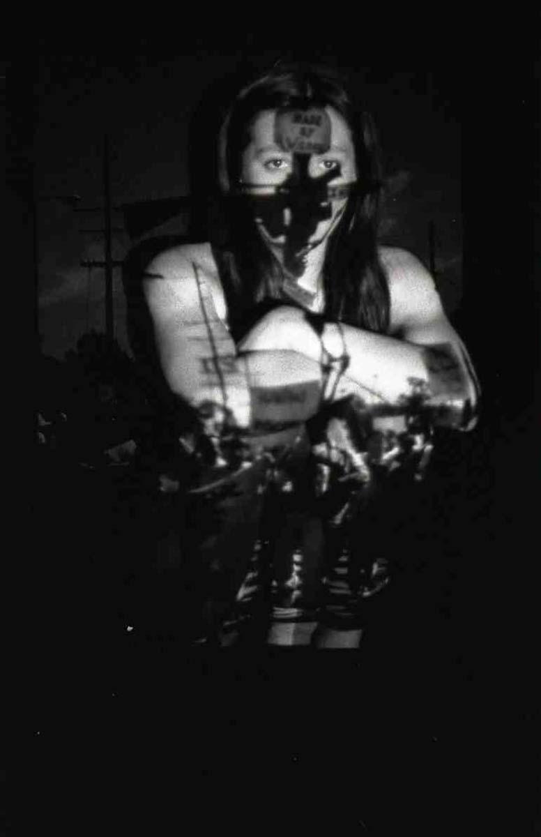 """""""Re-Membering: March Against 187"""" (1994), performative self portrait, black and white photo, 1999   Sandra de la Loza"""