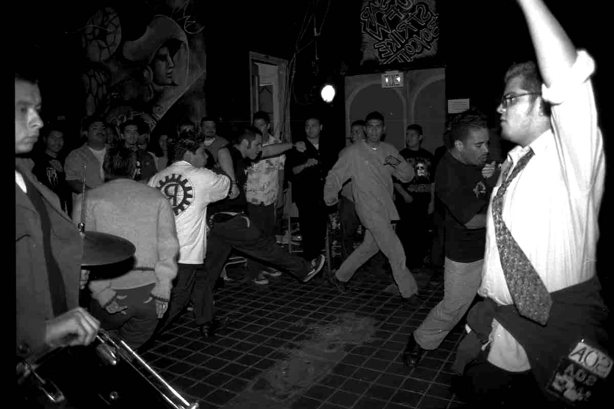 A gig, Aztlan Cultural Arts Foundation, black and white photo, 1999   Sandra de la Loza
