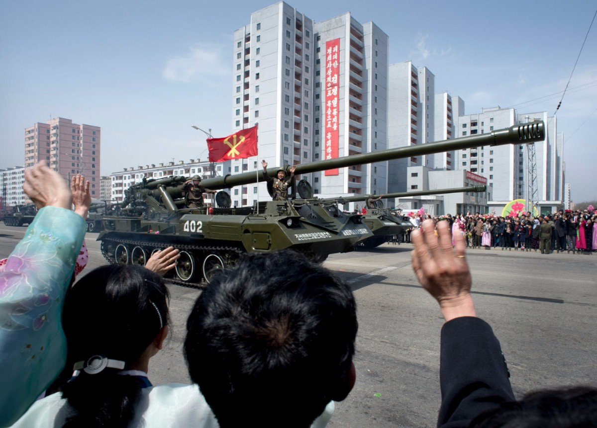 North Koreans wave to soldiers during a massive military parade celebrating the 100th anniversary of the birth of the country's founder Kim Il Sung. Pyongyang, North Korea | Mark Edward Harris