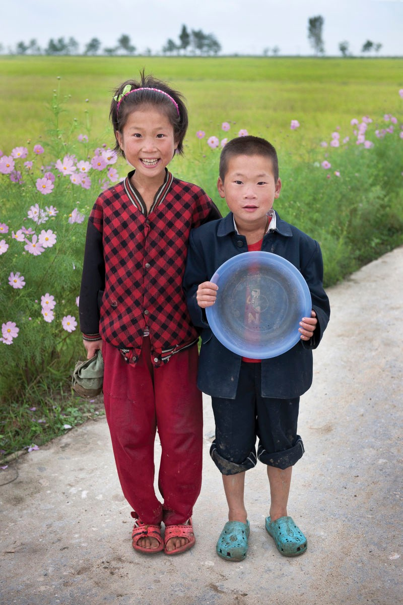 Two children at a communal farm in Kangwon Province, North Korea | Mark Edward Harris