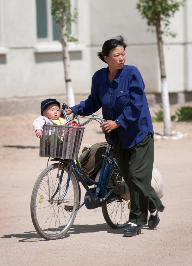 Mother and child in front of the Tumangang train station in North Korea | Mark Edward Harris/Getty Images