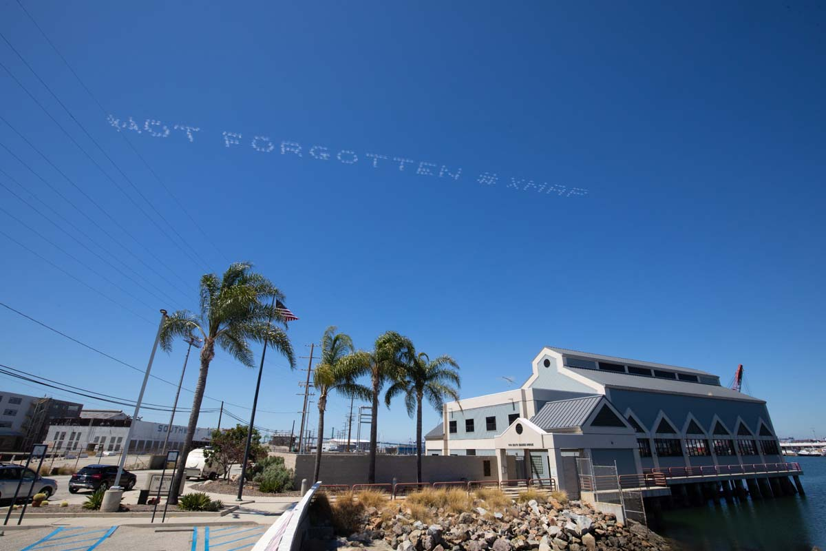 """""""NOT FORGOTTEN #XMAP"""" written in in the sky, contributed by Tina Takemoto over Terminal Island 