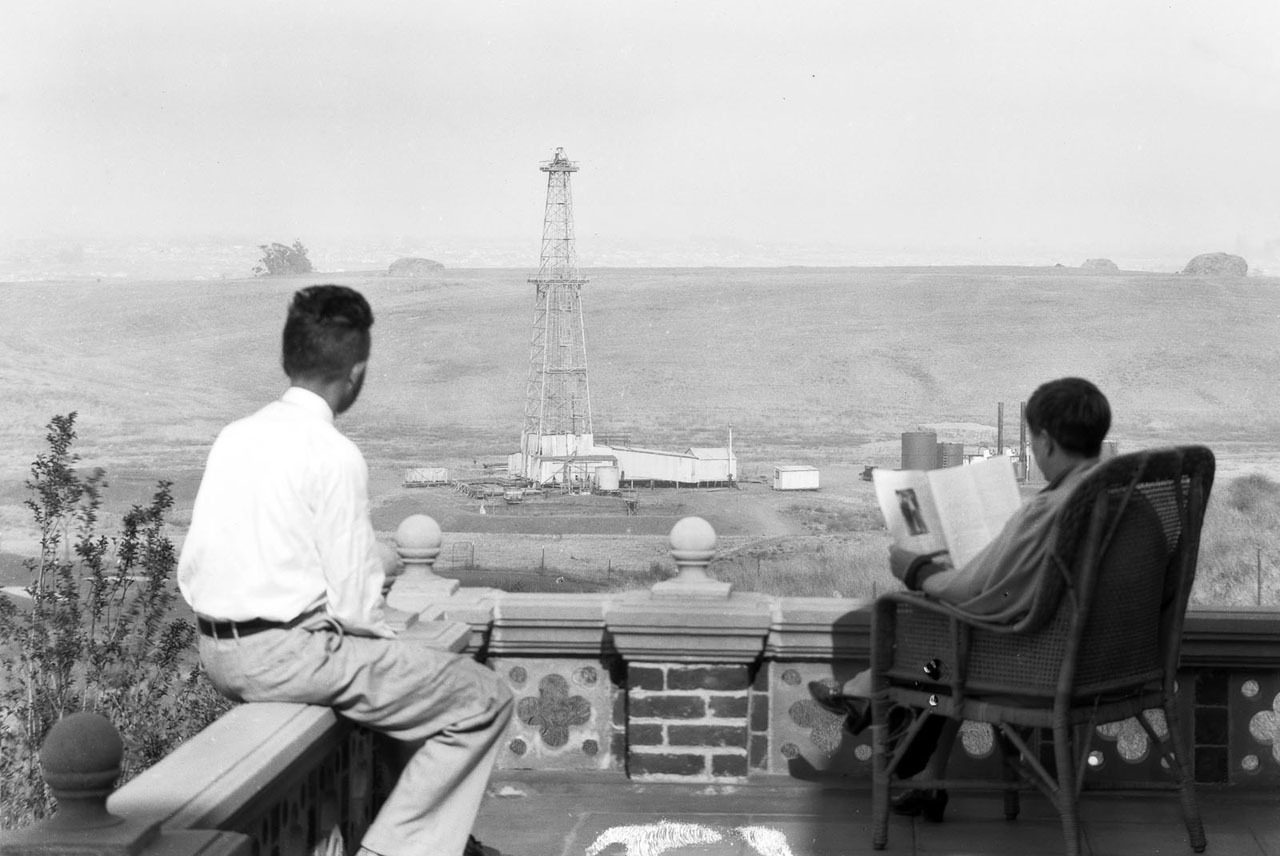 Standard Oil provoked a considerable uproar among real estate interests when it built this wildcat oil well next to a new, luxury housing tract in 1927. Courtesy of the USC Libraries - Dick Whittington Photography Collection.