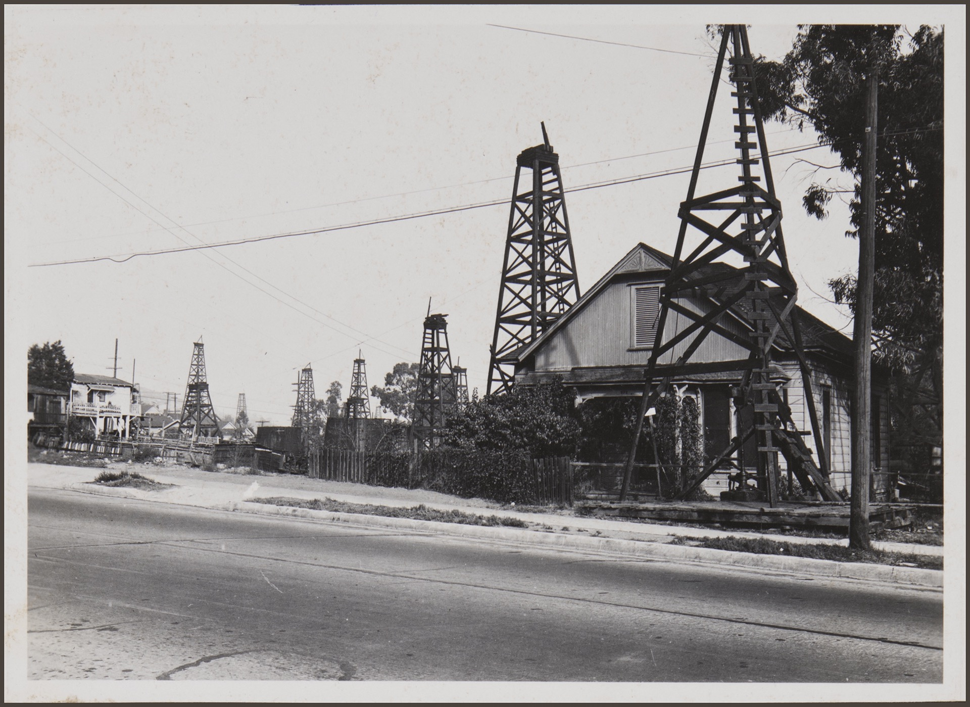 [Old oil wells still producing at Adobe Street]. Los Angeles: 1932-33 by Anton Wagner, PC 17, California Historical Society.