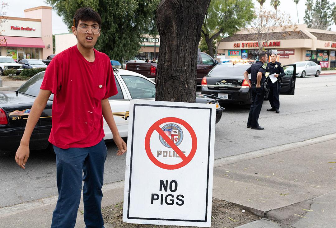 """Omar Solorio with his work """"No Pigs,"""" 2017.   Angel Xotlanihua."""