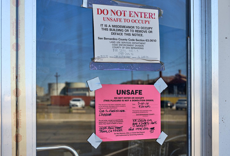 Earthquake damage notice. | Osceola Refetoff