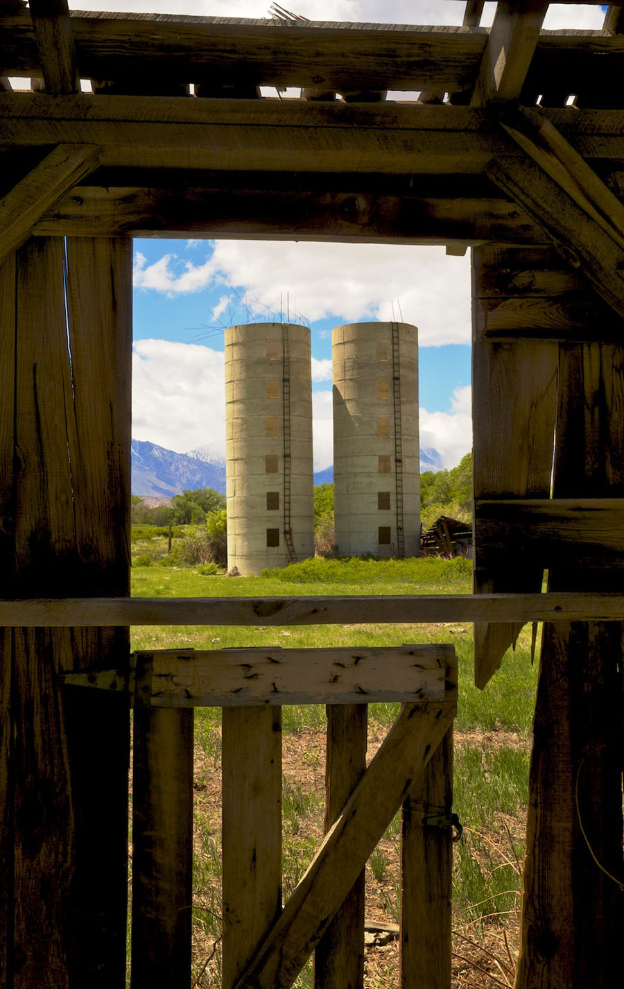 Window View of Twin Silos from Abandoned Barn - Bishop, CA - 2016 | Osceola Refetoff