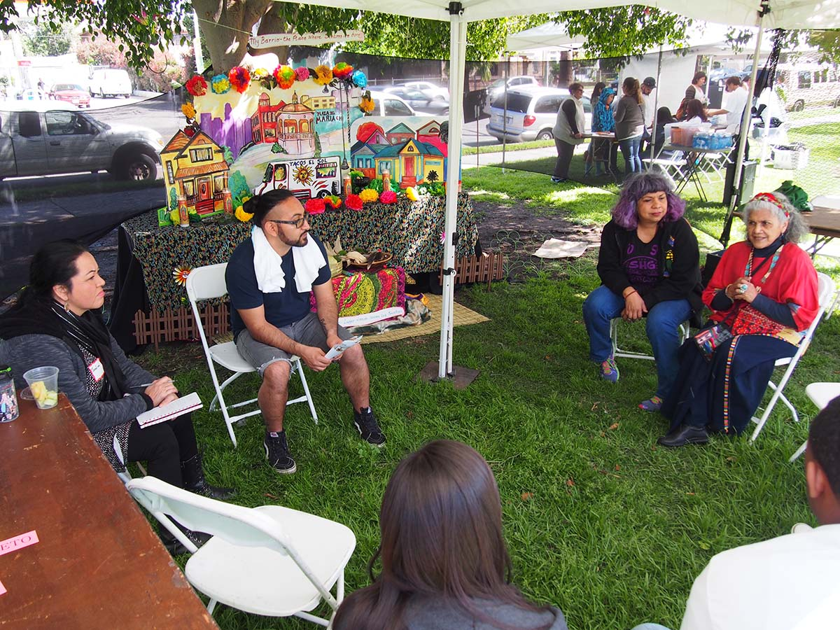 Ofelia Esparza (right) and Rosanna Esparza Ahrens (second from right) lead a group discussion at SaludArte, a community event in Boyle Heights that centered local cultural assets as tools for social change.  | Photo courtesy of ACTA