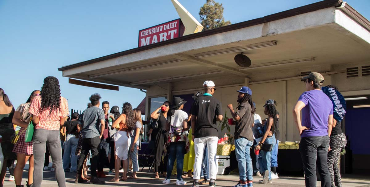 People gather at the Crenshaw Dairy Mart | Courtesy of Crenshaw Dairy Mart