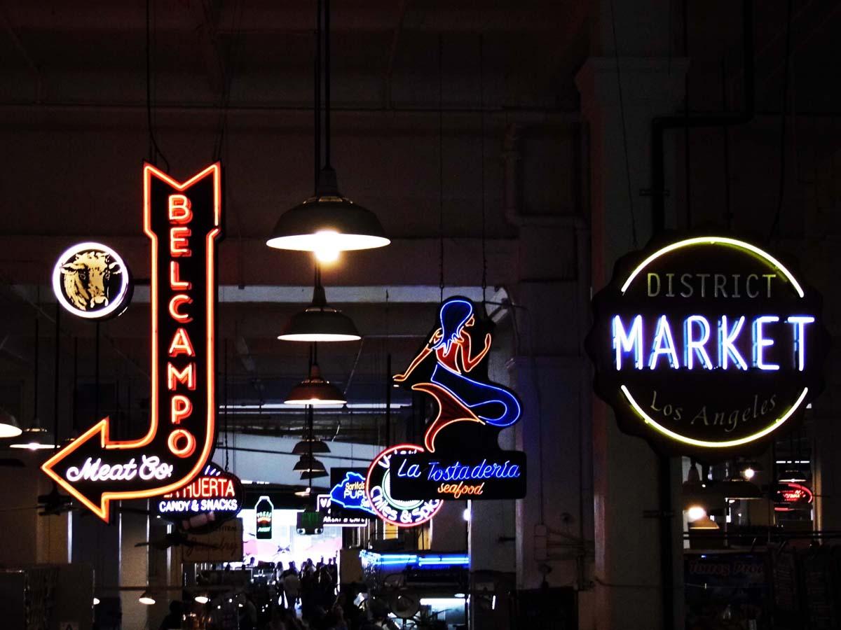 Vendor neon signs at Grand Central Market. | Sandi Hemmerlein