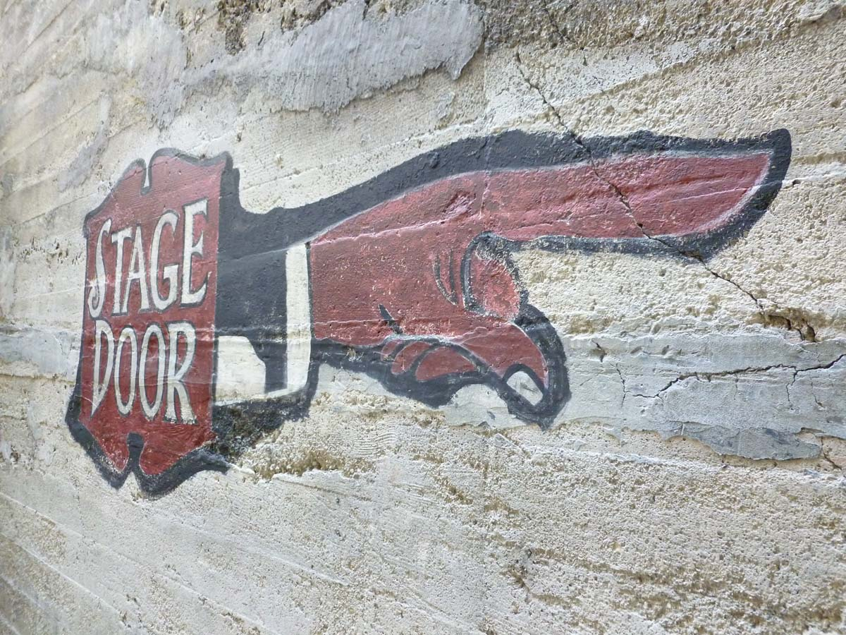 """A ghost sign at the Palace Theatre that reads """"Stage Door."""" 