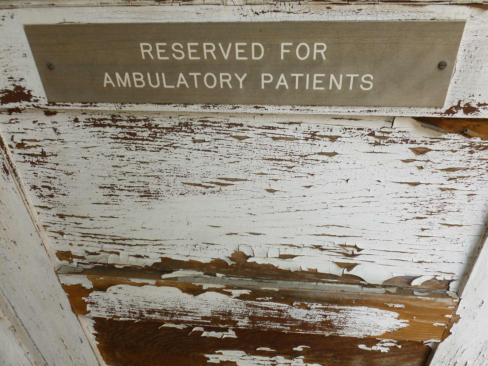 "A sign at a cottage across the Barlow Respiratory Hospital reads ""Reserved for ambulatory patients."" 