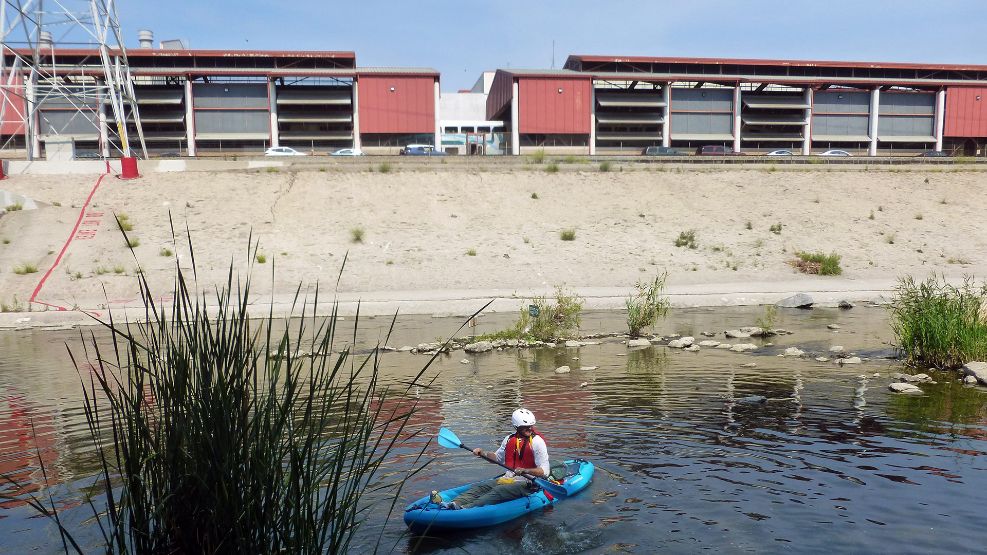A man paddles in the L.A. River. | Sandi Hemmerlein