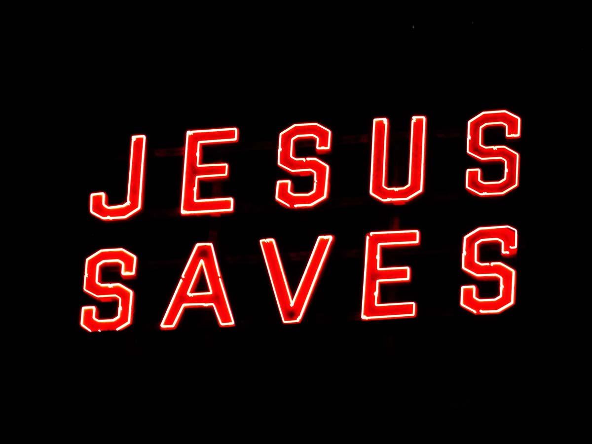 "The Ace Hotel's neon ""JESUS SAVES"" sign. | Sandi Hemmerlein"