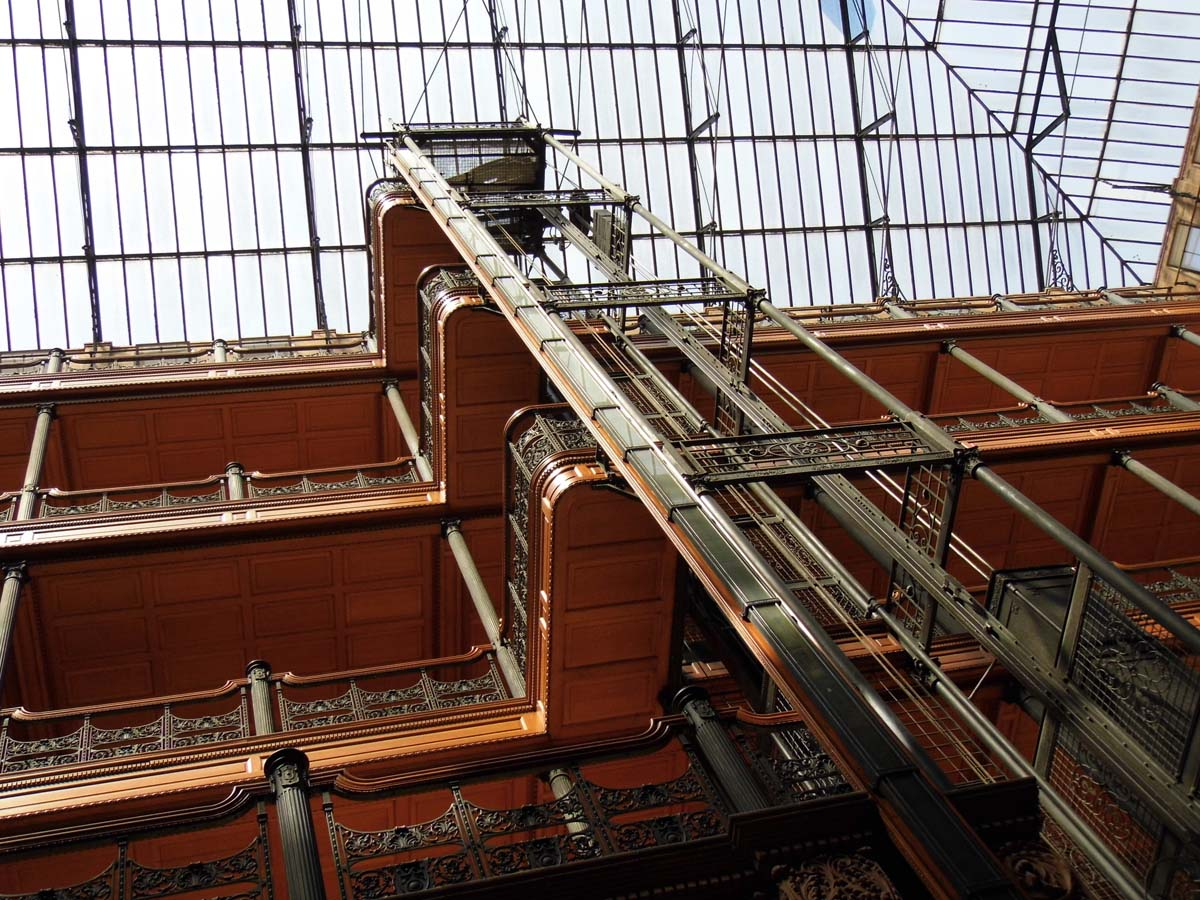 "The Bradbury's light-filled Victorian atrium, replete with ""birdcage"" elevators, decorative ironwork, marble flooring, and more. | Sandi Hemmerlein"