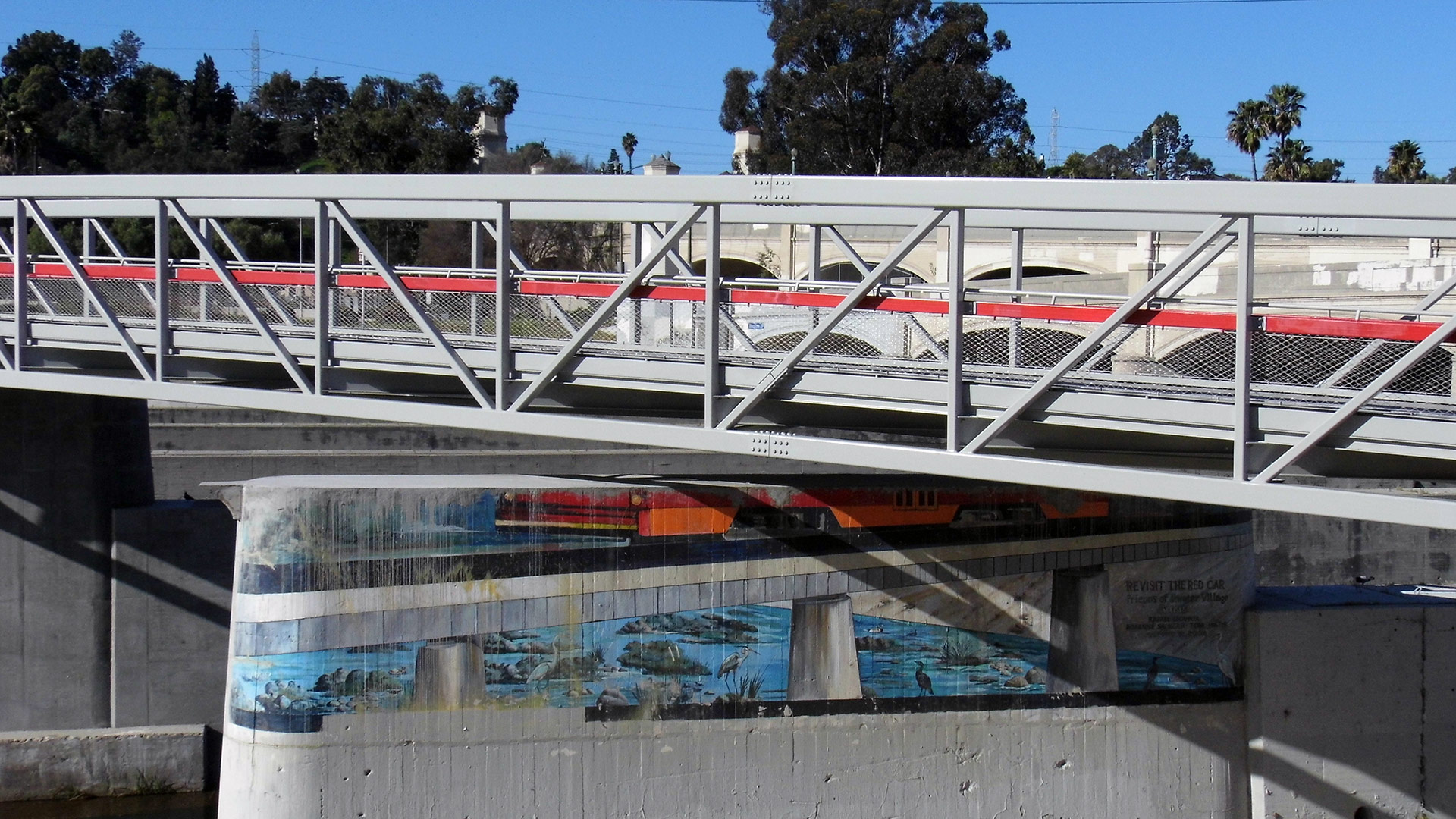 """The remaining portion of """"Revisit the Red Car"""" by Rafael Escamilla at the new pedestrian bridge at the Glendale-Hyperion Bridge complex. 