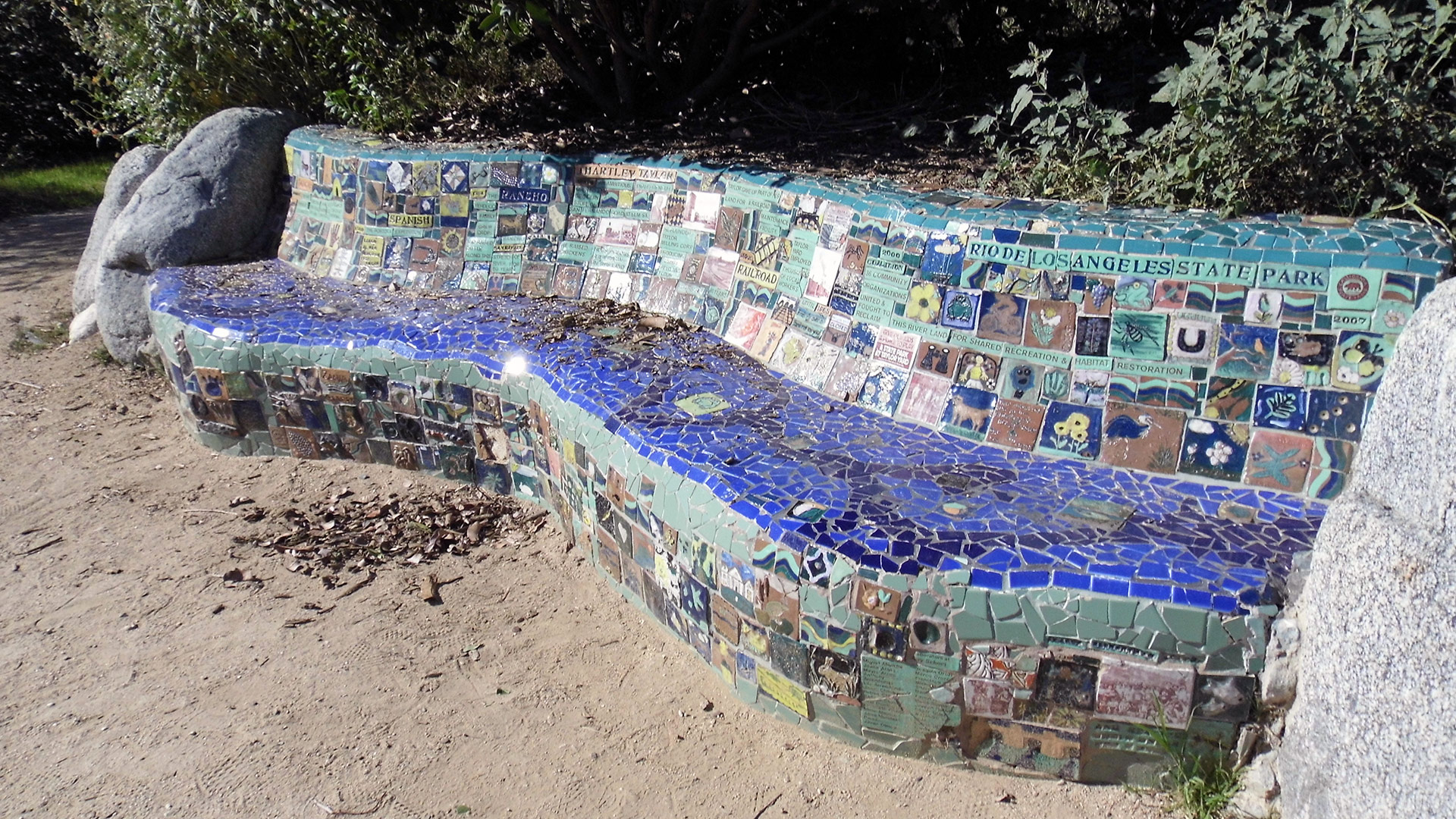 A community-created bench at Rio de Los Angeles State Park tells the diverse history of the parkland in mosaic tile. | Sandi Hemmerlein