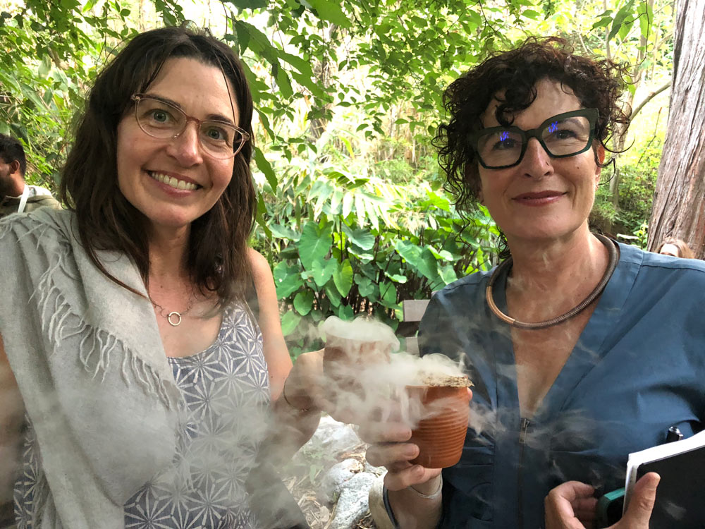 "Sasha Davies and Marina Zurkow enjoying a drink of ""Panthalassa Dashi and Pangaea Crisp,"" Making the Best of It, garden tasting and dinner at the Mildred Mathias Botanical Garden, UCLA, 2018 