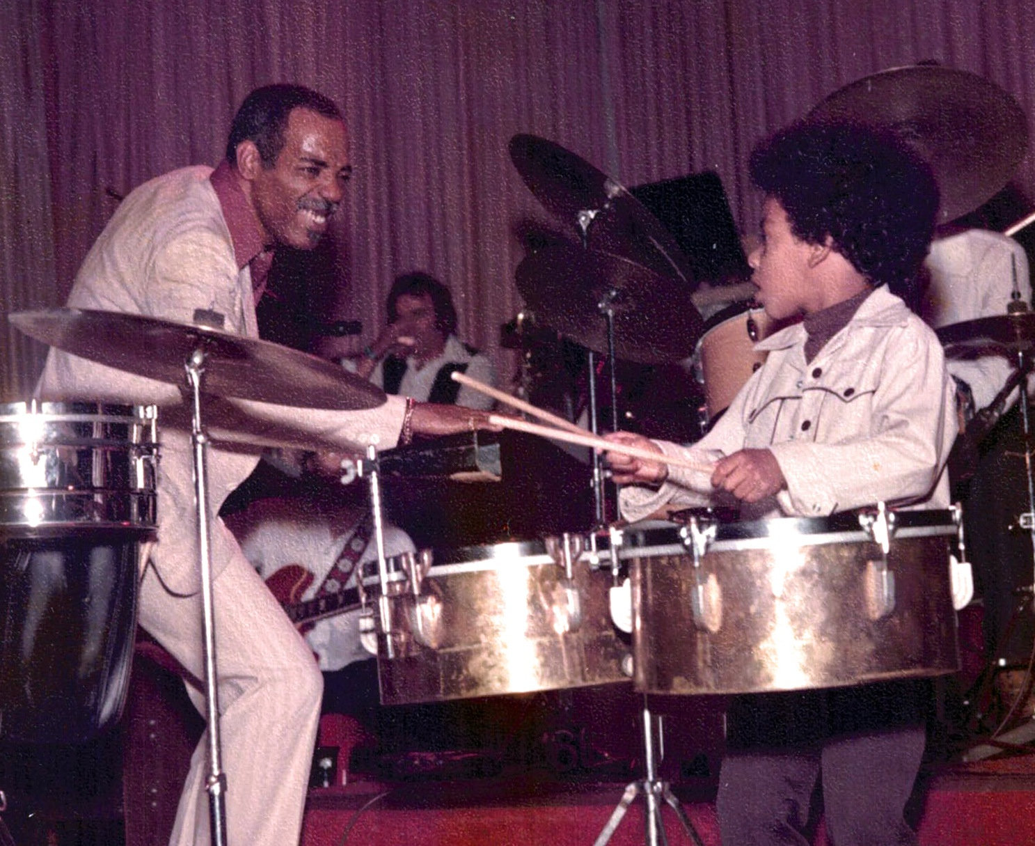 Photo of percussionist Willie Bobo with son Eric Bobo