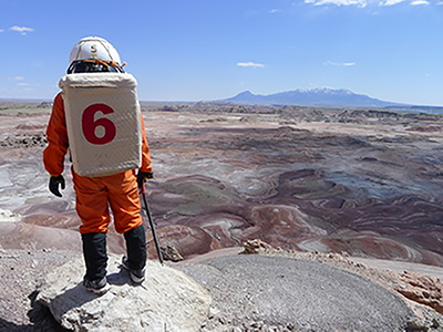Pete Morgan-Dimmick standing halfway up Picard Butte. | Josh Borchardt