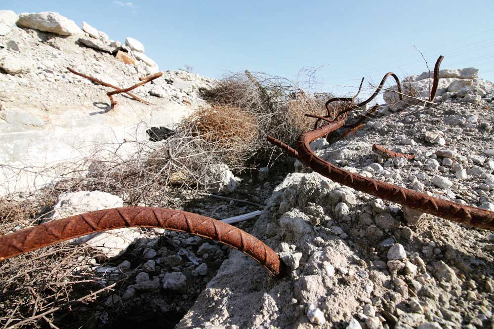 Bent rebar and broken concrete at Taylor Yard | Courtney Cecale