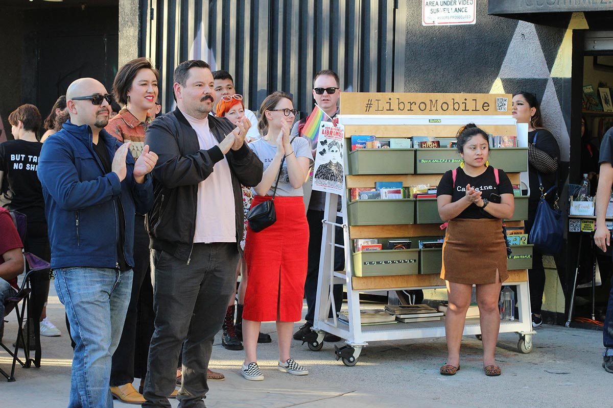 Local poet Gustavo Hernandez and book advisor Selena Pineda stand among other attendees at the first Annual LibroMobile Literary Arts Festival in 2019. | Cecilia Lopez, Courtesy of Sarah Rafael García