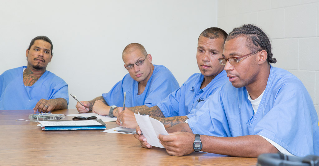 Prison inmates participate in a Playwrights Project theater workshop at Richard Donovan Correctional Facility in San Diego
