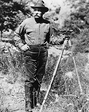 Portrait of William Mulholland with a surveyors scope on a tripod (1908-1913)