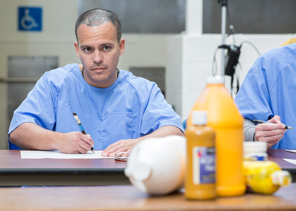 A prison inmate at Richard J. Donovan Correctional Facility in San Diego participates in a still life drawing exercise conducted by Project PAINT.