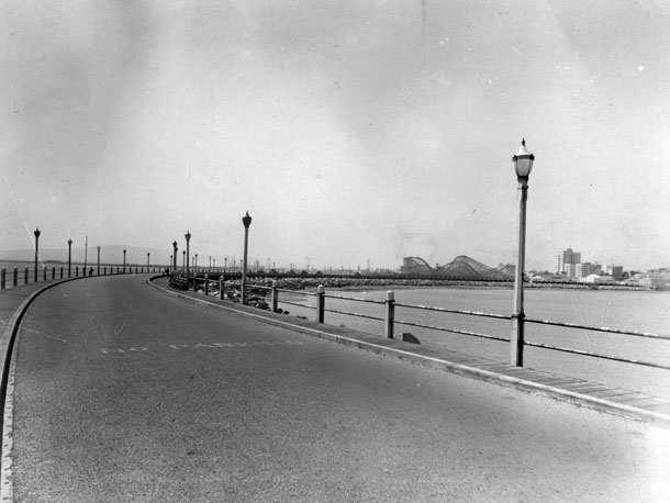 A 1937 view of Rainbow Pier with one of Long Beach's seaside roller coasters in the distance. Courtesy of the Photo Collection - Los Angeles Public Library.