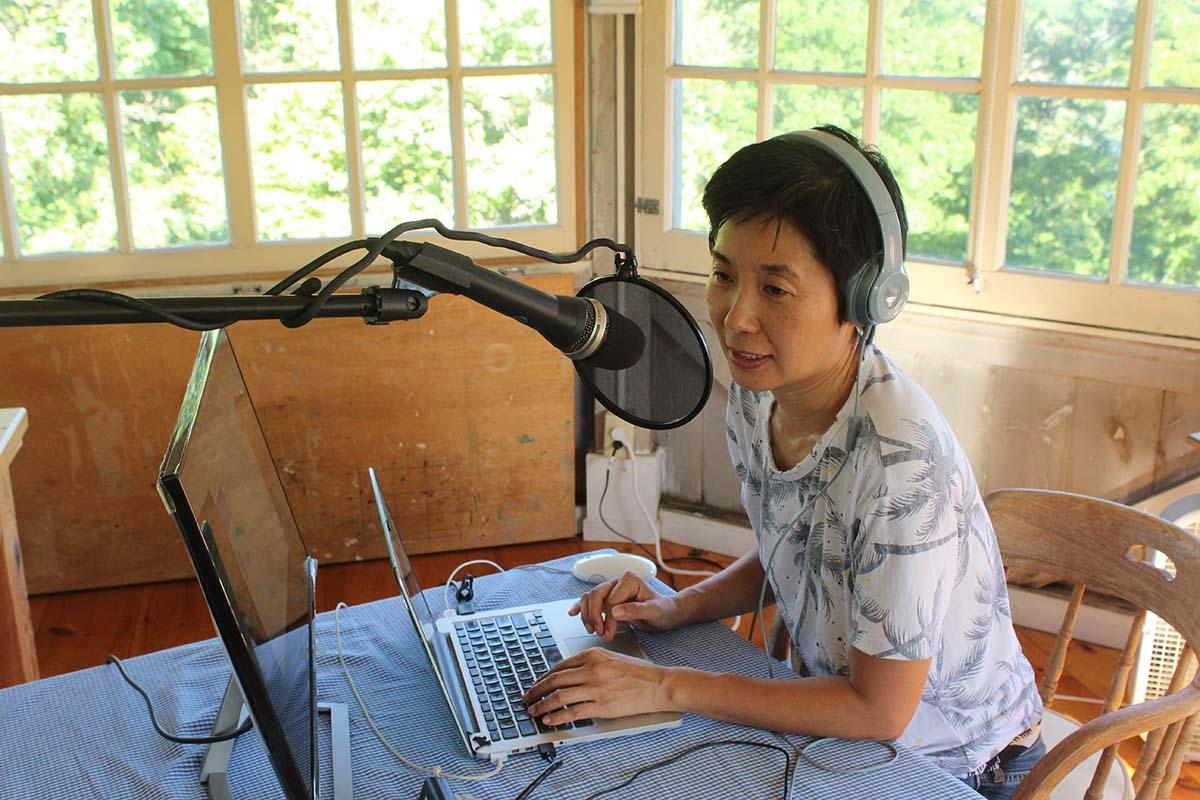 Reina Higashitani working on her podcast series during an artist residency in upstate New York | Courtesy of Reina Higashitani