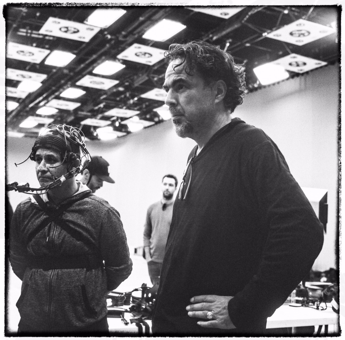 – Alejandro G. Iñárritu directing a baker from El Salvador named Yoni. Yoni is dressed in a motion-capture suit and recreating a harrowing moment on his journey. Photo credit: Chachi Ramirez.