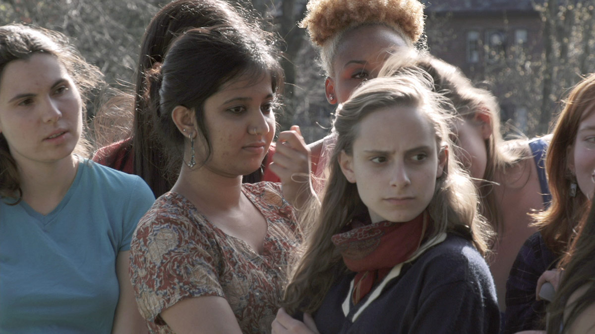 """An image from Sharon Hayes' """"Ricerche: three"""" (2013), featuring female students from Mt. Holoyoke College. 
