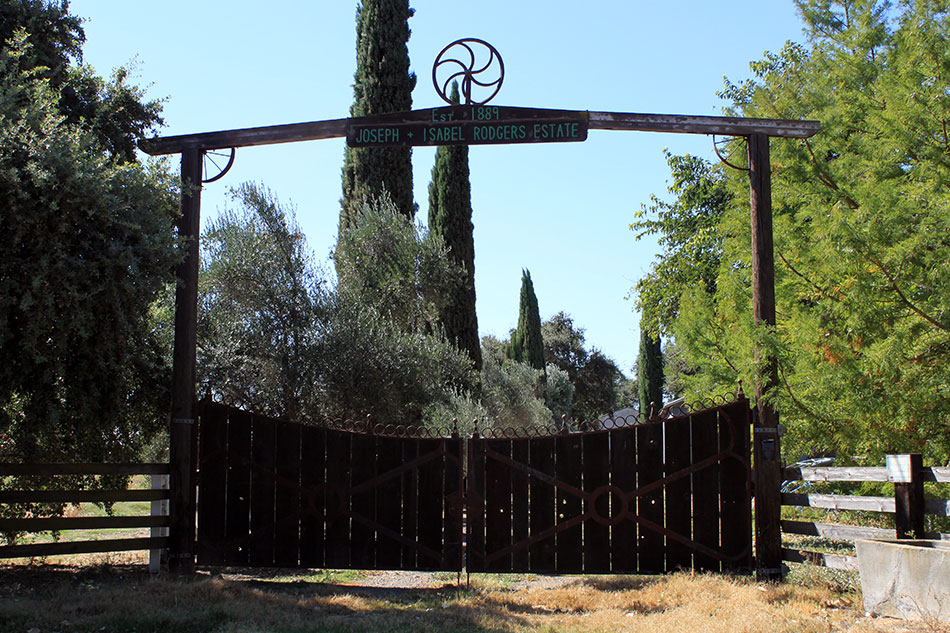 "Outdoor Wooden Gate Reading ""Est. 1889 - Joseph + Isabel Rodgers Estate"""