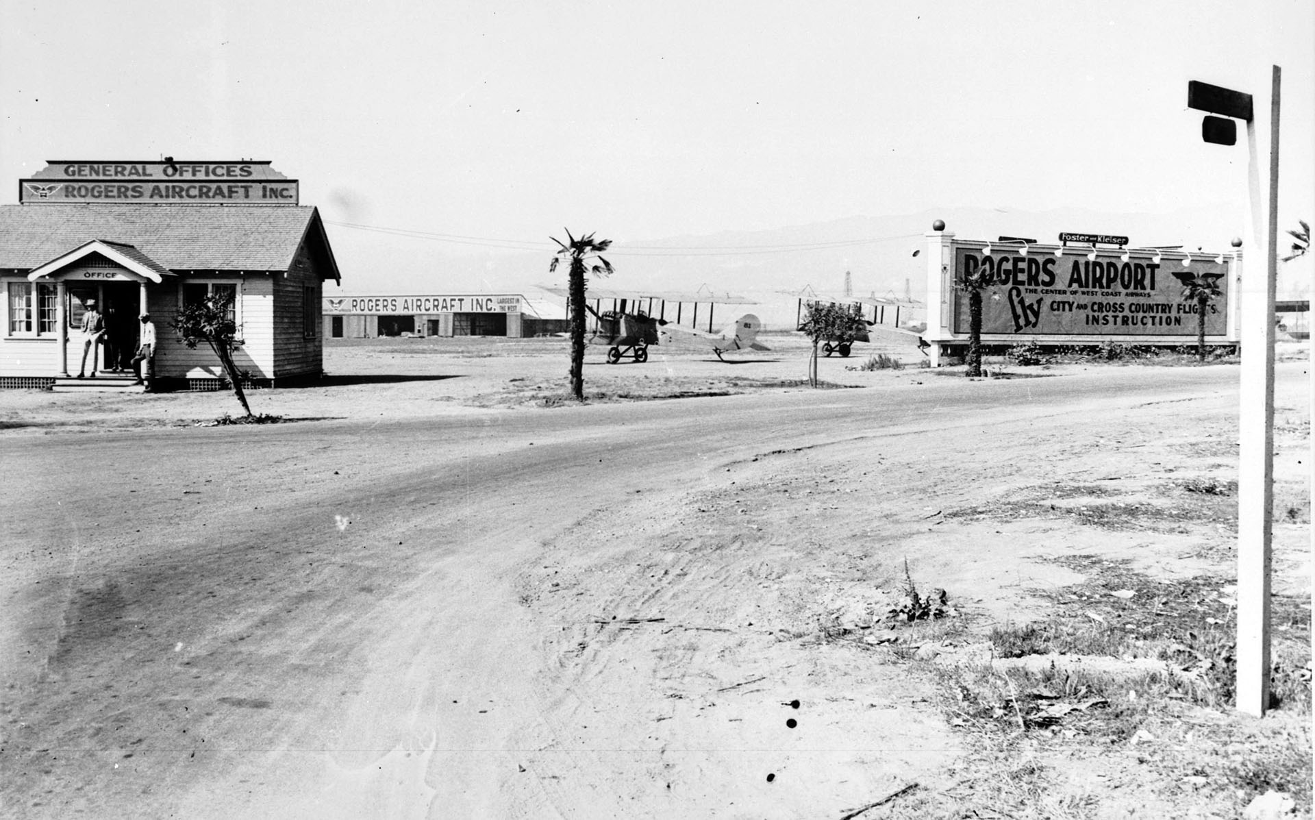 View of Rogers Airport, located at the corner of Wilshire Boulevard and Fairfax Street, looking west toward the general office and hangars, 1922