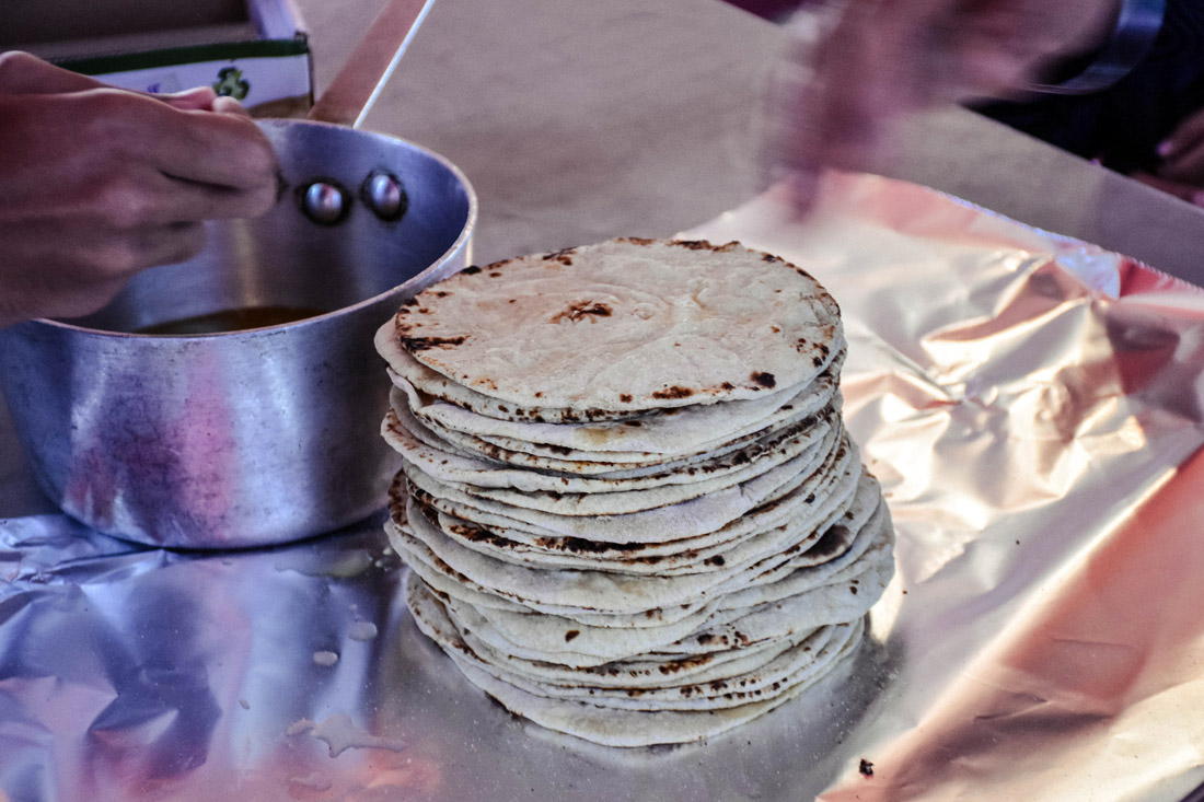 From dough to grill, the roti is molded, shaped, grilled, and then brushed with butter.