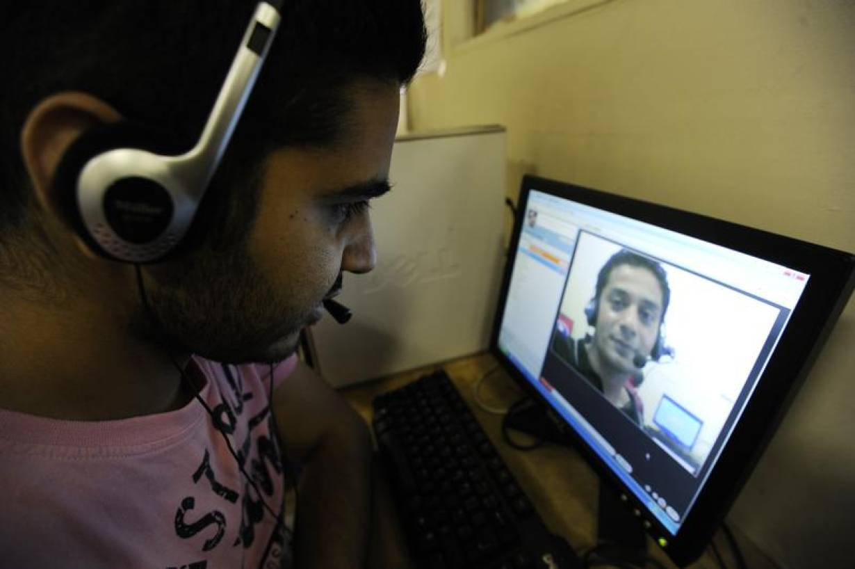 RCHIVE PHOTO: A man speaks to his friend using Skype at an internet cafe in central London August 10, 2010. | REUTERS/Paul Hackett