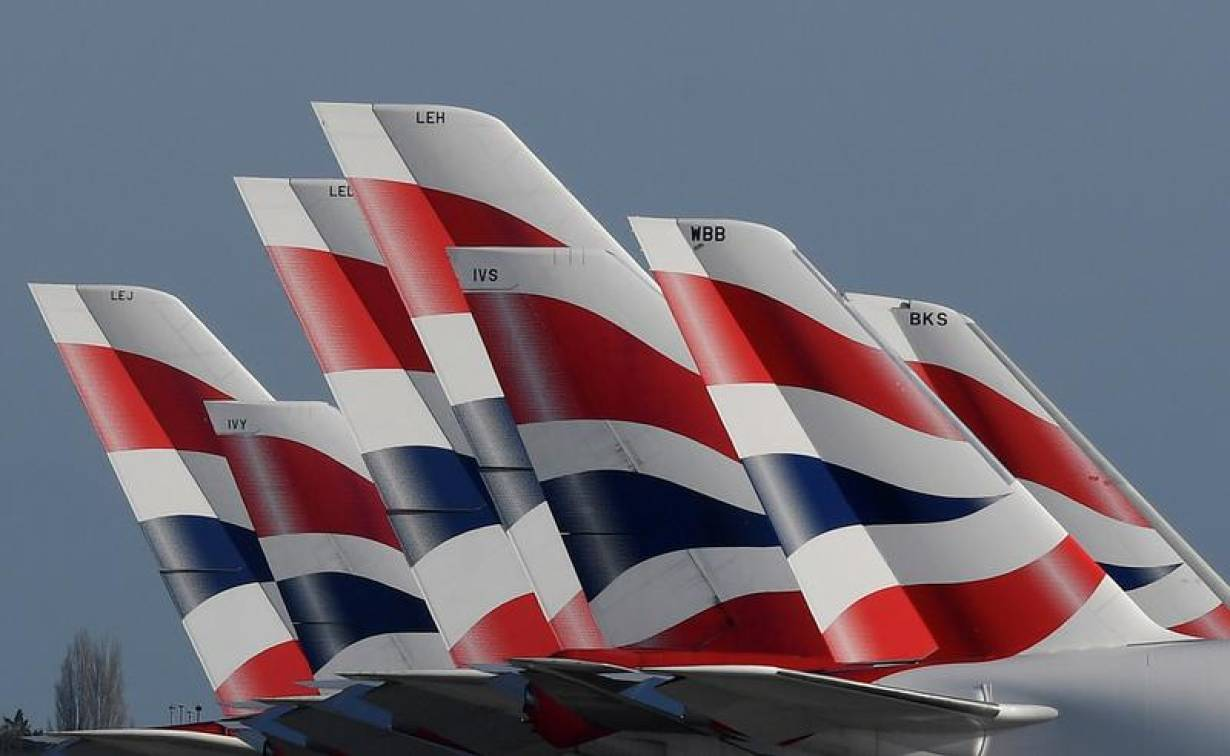 Tail Fins of British Airways planes are seen parked at Heathrow airport as the spread of the coronavirus disease (COVID-19) continues, London, Britain, March 31, 2020. | REUTERS/Toby Melville