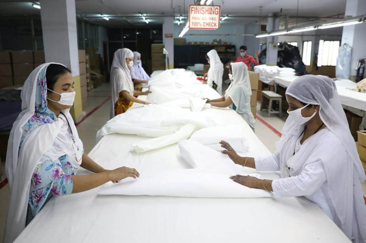 Bangladeshi garment workers make protective suit at a factory amid concerns over the spread of the coronavirus disease (COVID-19) in Dhaka, Bangladesh, March 31, 2020.   REUTERS/Mohammad Ponir Hossain