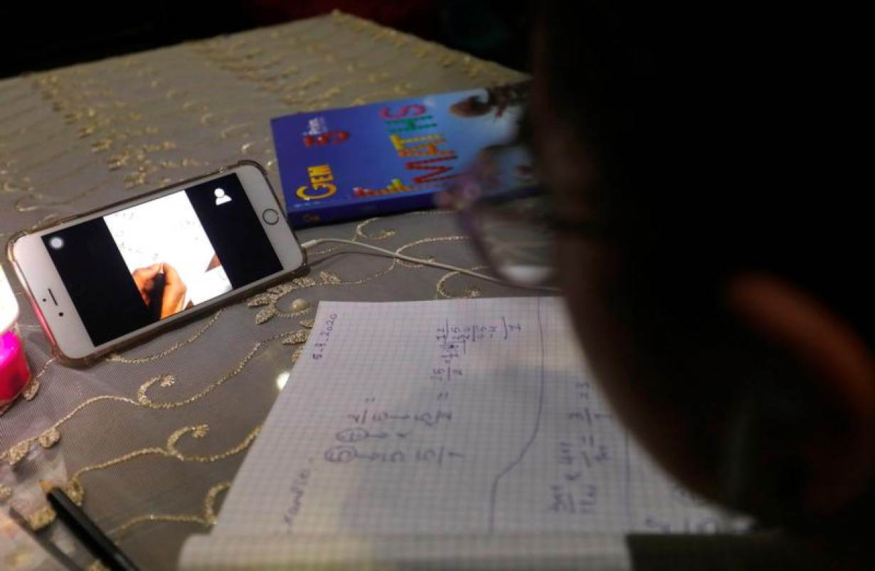 A student takes class online while using the Zoom app at her home as Egypt shut down schools as the spread of the coronavirus disease (COVID-19) continues, in Cairo, Egypt April 5, 2020. | REUTERS/Amr Abdallah Dalsh